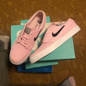 Nike pink and white men's shoes.